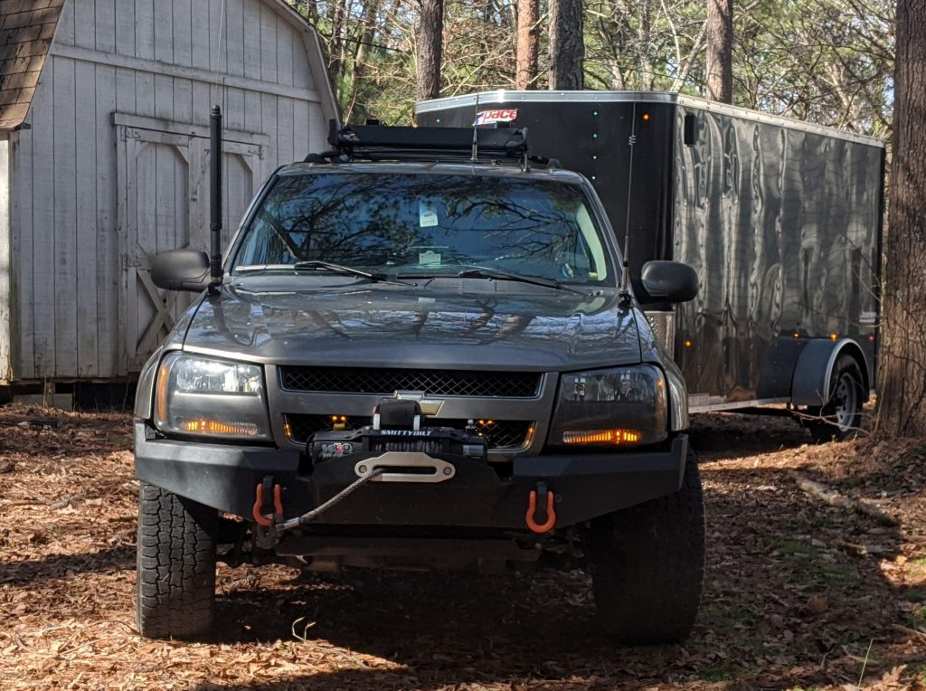 My off-road vehicle with HF and VHF/UHF antennas mounted to the hood for Amateur Radio off-road communications.